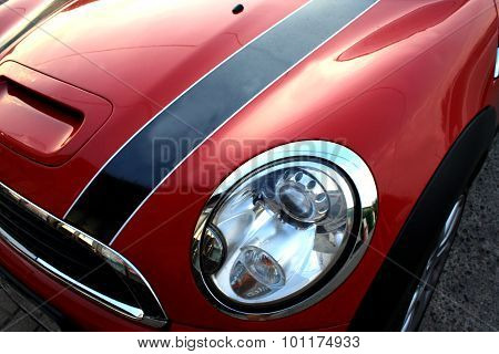 Red And Small Sport Car - Isolated Part With Headlight And Blinker.