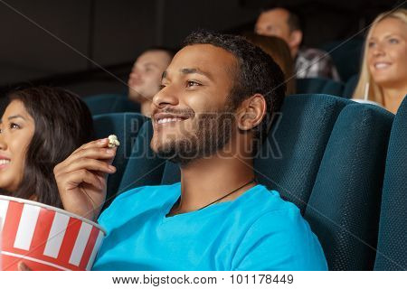 Smiling young man at the movie theatre