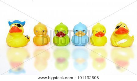 a group of toy rubber ducks