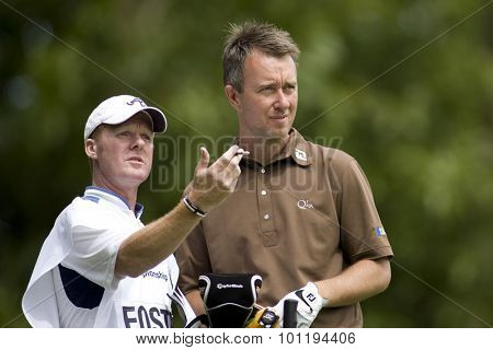 WENTWORTH, ENGLAND. 23 MAY 2009.Mark FOSTER ENG  and his caddy discuss a shot playing in the 3rd round of the European Tour BMW PGA Championship.