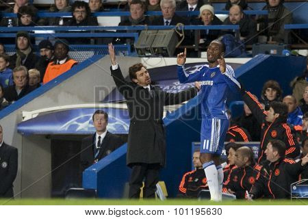 LONDON, ENGLAND. 06 DECEMBER 2011. Chelsea's Portuguese manager Andre Villas-Boas and Chelsea's  forward Didier Drogba in action during the UEFA Champions League match between Chelsea and Valencia