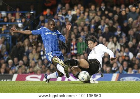LONDON, ENGLAND. 06 DECEMBER 2011. Chelsea's Brazilian midfielder Ramires and Valencia's Argentinian midfielder Tino Costa in action during the UEFA Champions League match between Chelsea and Valencia