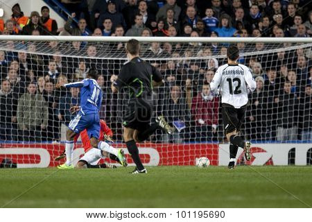 LONDON, ENGLAND. 06 DECEMBER 2011. Chelsea's Ivory Coast forward Didier Drogba scores the 3rd goal during the UEFA Champions League match between Chelsea and Valencia