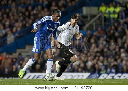 LONDON, ENGLAND. 06 DECEMBER 2011. Chelsea's Ivory Coast forward Didier Drogba and Valencia's midfielder David Albelda  in action during the UEFA Champions League match between Chelsea and Valencia