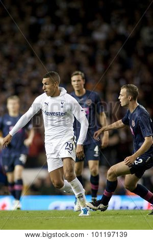 LONDON ENGLAND 25 August 2011. Tottenham's Jake Livermore and Hearts player Gordon Smith in action during the UEFA Europa league match between Tottenham Hotspurs  and Hearts. Played at White Hart Lane