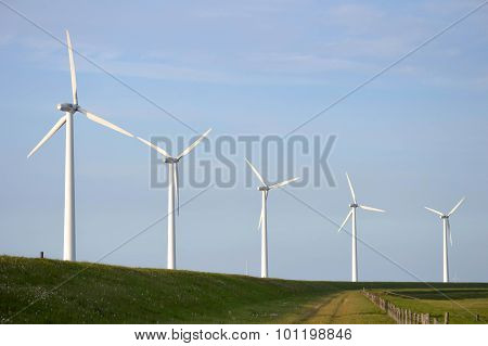 Wind turbines in a row