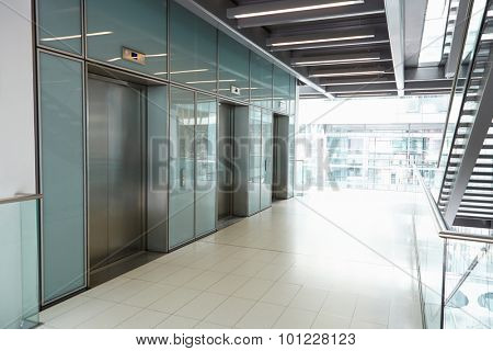 Elevators in the empty corridor of a corporate business
