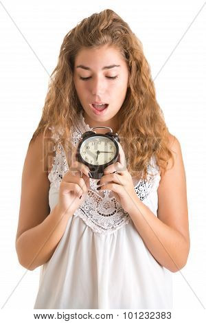 Woman looking surprise at an alarm clock isolated