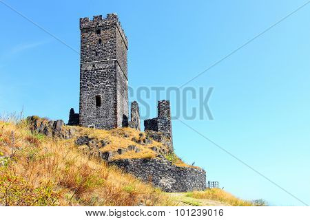 Ruins of gothic castle Hazmburk (Klapy) nearby Prague in Czech Republic. Central Europe.