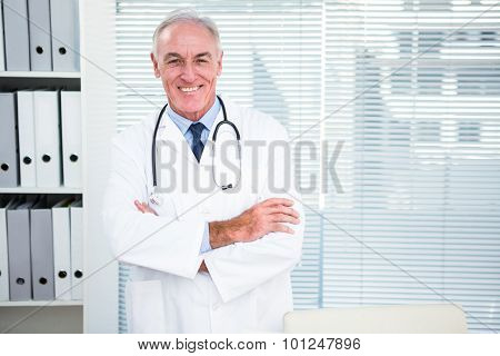 Portrait of smiling doctor with stethoscope around his neck at clinic