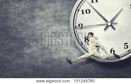 Concept of time with funny businessman running in a hurry poster