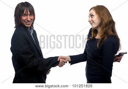 Woman, man, handshake and the gun