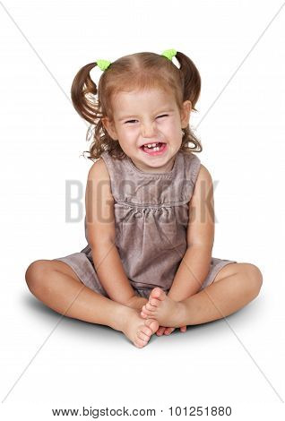 Portrait Of Sitting Angry Child Girl With Grin Isolated On White