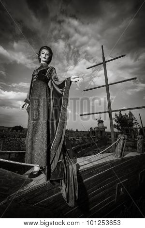 Woman In Aristocratic Clothes On Boat
