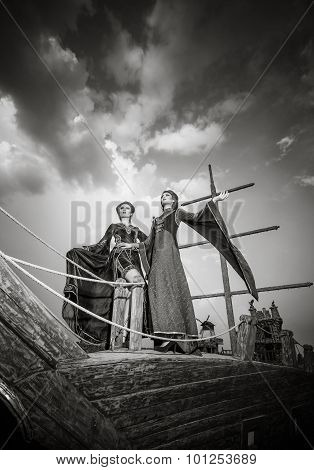 Two Elegant Woman In Extravagant Antique Luxury Clothes On Boat