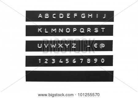 Embossed alphabet on black plastic tape