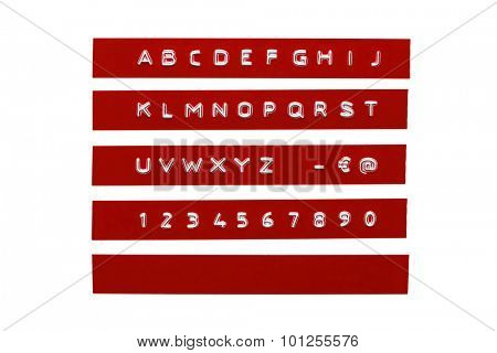 Embossed alphabet on red plastic tape