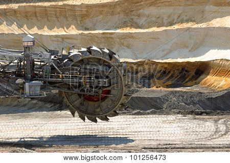 Giant bucket wheel excavator machine in a open pit mine