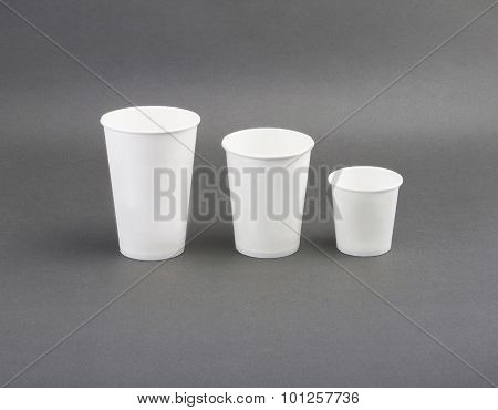 Coffee drinking cup sizes. Paper coffee cup on a grey background poster