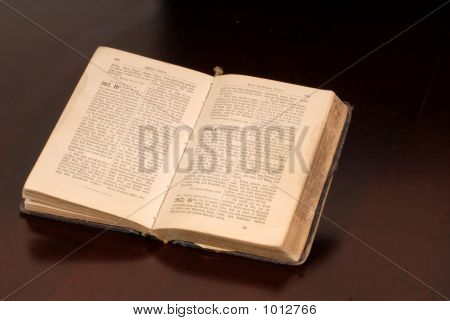 An Open Old German Bible Resting On A Table