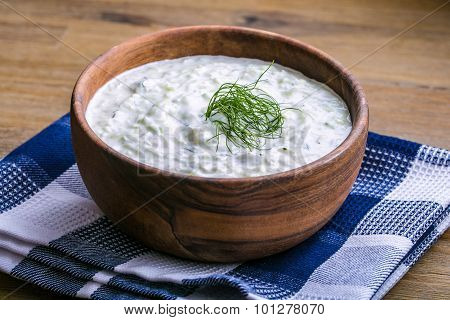 Tzatziki. Greek salad tzatziki  of cucumber, yogurt or cream, olive oil, garlic, dill and spices.