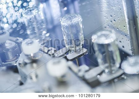pharmaceutical medicine industrial washer cleaning and drying machine for powder drugs glassware bottles. Shallow DOF