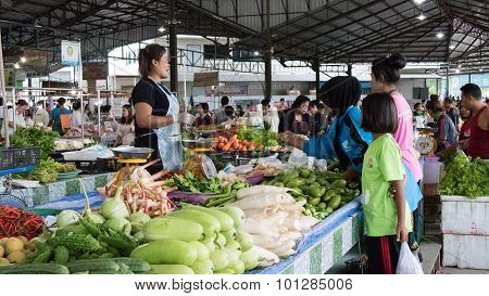 People Buy And Sell Food In The Local Market