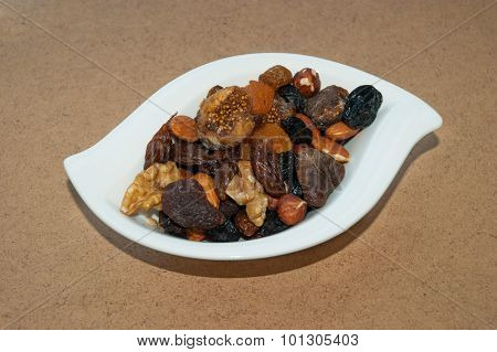 Dried Fruits And Nuts On Brown