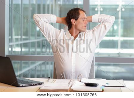 white collar worker male stretching arms, relaxing neck - short break for exercise on chair in office poster