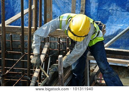 A construction workers fabricating pile cap formwork