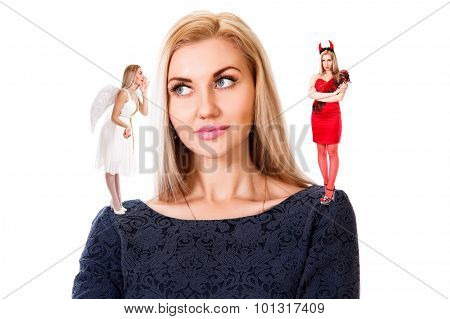 Young Woman With Small Angel And Demon On Her Shoulders