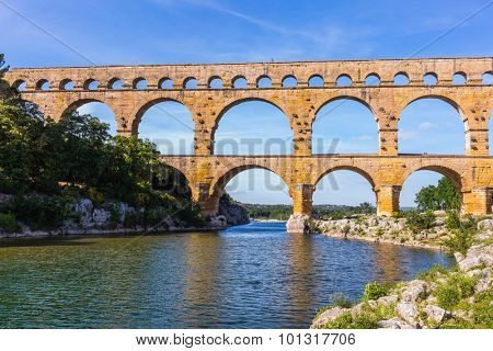 The bridge was built in Roman times on the river Gardon. Three-tiered aqueduct Pont du Gard - the highest in Europe. Provence, spring sunny day