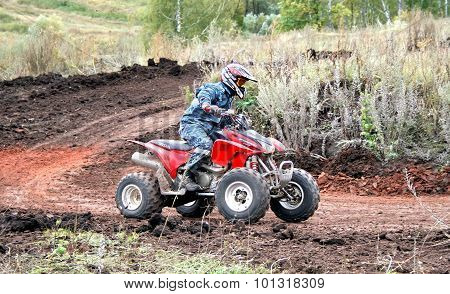 ALKINO, RUSSIA - SEPTEMBER 20: Undefined competitor's quad bike Honda Sportrax 450R competes at the annual Motor show