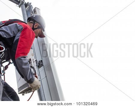 repairman on a telecommunications tower installs transmitter mobile poster