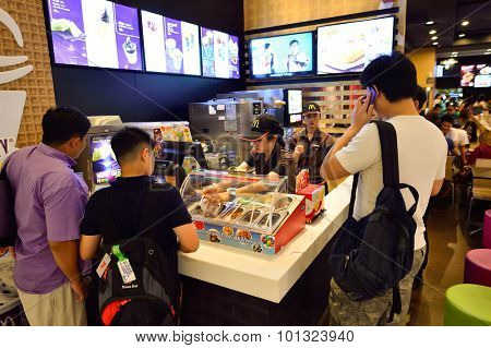 BANGKOK, THAILAND - JUNE 21, 2015: McDonald's restaurant interior. The McDonald's Corporation is the world's largest chain of hamburger fast food restaurants