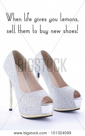 High Heel Rhinestone Shoes with Funny Saying Text When life gives you lemons sell them to buy new shoes on white background. poster