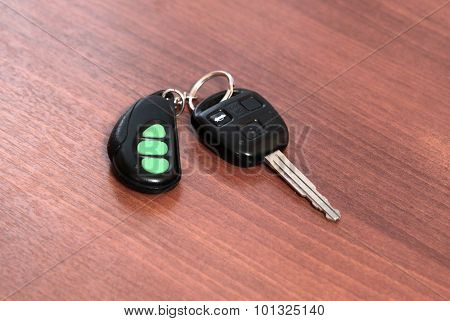 car key with remote on a wooden table