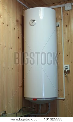 Electric Water Heater Hanging On The Wooden Wall