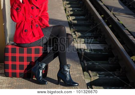 Elegant Fashionable Lady Waiting For The Train On The Train Station On Sunny Day