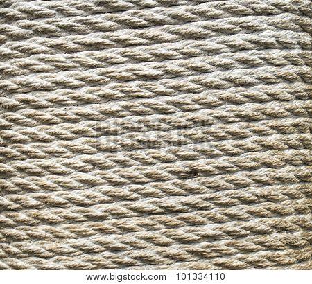 Ecru Thick Rope Wrapped Around A Pillar