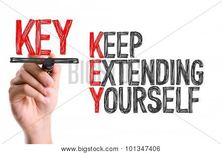 Hand with marker writing the word Keep Extending Yourself poster