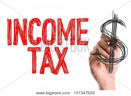 Hand with marker writing the word Income Tax