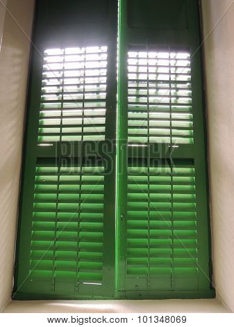 Sunlight Passing Through Green Shutters