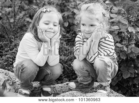 Two Happy Little Girls Playing