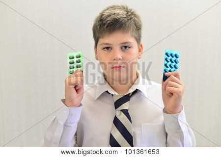 Teenage Boy With The Medicine In His Hands