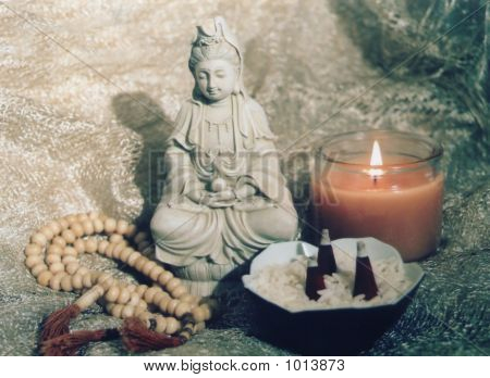 buddhist quan yin altar with mala beads candle and incense poster
