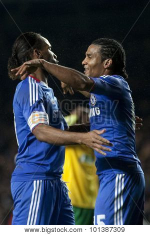 LONDON ENGLAND 23 NOVEMBER 2010. Chelsea's forward Didier Drogba  and Chelsea's midfielder Florent Malouda celebrate Malouda's goal during the UEFA Champions League match