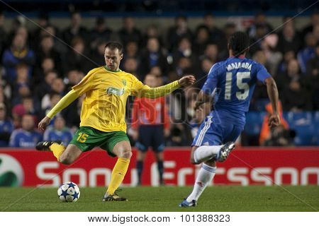 LONDON ENGLAND 23 NOVEMBER 2010. MSK Zilina's defender Jozef Piacek and Chelsea's midfielder Florent Malouda in action during the UEFA Champions League match between Chelsea FC and MSK Zilina