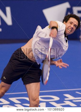 LONDON, ENGLAND. 04 DECEMBER 2009 -   Younes El Aynaoui (MOR) serving the ball during the match with Mark Philippoussis (AUS) during the AEGON Masters Tennis, Royal Albert Hall, London.