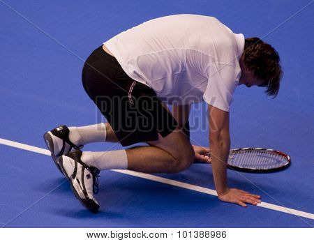 LONDON, ENGLAND. 05 DECEMBER 2009 -   Goran Ivanisevic (CRO) colapses whilst competing in the season finale to the ATP Champions Tour match between Rafter and Ivanisevic